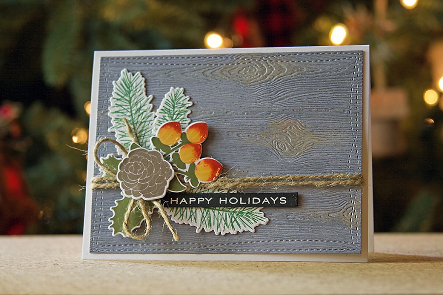 A weathered wood background for holiday cards using Copic markers and texture paste.